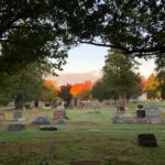 Colestown Cemetery with autumn foliage in background