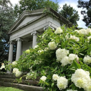 mausoleum at harleigh cemetery with white hydrangea flowers